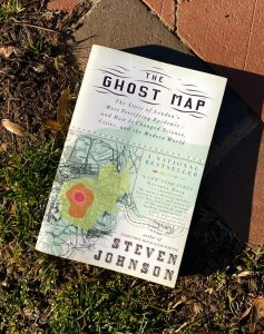 the front of The Ghost Map by Steven Johnson against a background of old red brick and grass