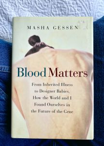 front cover of Blood Matters by Masha Gessen with blue jeans and a white bedspread in the background